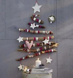 Wall Christmas Tree Decorating Ideas is a new modern method to change the Christmas tree from traditional tree to of wall tree. With the charming wall Christmas Unusual Christmas Trees, Driftwood Christmas Tree, Wooden Christmas Trees, Noel Christmas, Modern Christmas, Christmas Tree Decorations, Beautiful Christmas, Cabin Christmas, Purple Christmas