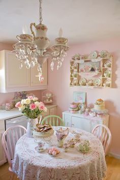 Love the English tea party inspired chandelier. This is definitely my next project.