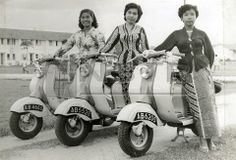 Vintage photo of three women with Vespas.  Year / Location unknown.  If anyone can help me with this information, I'd be very grateful!  Thanks.