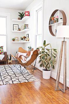 floating corner shelves; butterfly chairs; tripod lamp; ABM living room makeover