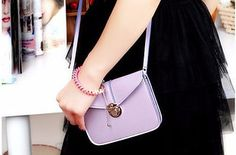 This lilac number that pairs well with other pastels or even with bright bold colors. | 27 Tiny Purses For Tiny Prices