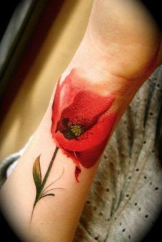 Poppy wrist tattoo with watercolor tattoo technique