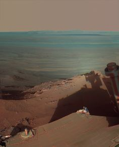 Dark Shadows on #Mars: Scene from Durable #NASA Rover.  NASA's Mars Exploration Rover Opportunity has used a low sun angle for a memorable view of a large Martian crater.  The resulting view catches a shadow of the rover in the foreground and the giant basin in the distance. Opportunity is perched on the western rim of Endeavour Crater looking eastward.   http://marsrover.nasa.gov/newsroom/pressreleases/20120522a.html