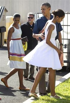 President Barack Obama, first lady Michelle Obama and their daughters arrive to attend Christmas service at the Kaneohe bay Chapel on Marine Corps Base in Kaneohe, Hawaii on Dec. 25, 2011.