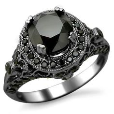 Gothic engagement ring, black diamond, black gold ring | From Blog: 25 Black Diamond Engagement Rings via InkedWeddings.com