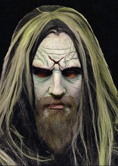 """Rob Zombie Mask - Why settle for a generic monster makeover when you can become horror legend Rob Zombie?  This amazingly accurate 3/4 mask leaps straight off the cover of Zombie's hit album Hellbilly Deluxe, complete with beard, wig, and Mansonesque """"X"""" carved into the forehead. #robzombie #yyc #costume #mask"""