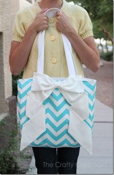 Nappy Bag or general bag. Too bad I dont sew or own a sewing machine. Love the bow!