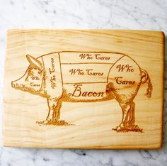 Maple wooden cutting board, engraved with a vintage pig butcher's diagram that we altered to show where the bacon is and the fact that the bacon is all that matters. There are two kinds of people in t