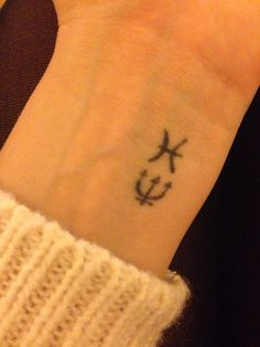 Wrist tattoo - top one means Pisces and the bottom is Pisces ruling planet Neptune!