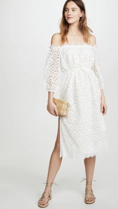 Little White dresses for brides in lace, sparkle, and sleek silhouettes. As couples turn to more intimate gatherings or even to elopements, short wedding dresses are gaining popularity. We've put together a shoppable guide of the best short wedding dresses you can buy online! #gws #greenweddingshoes #littlewhitedresses #shortweddingdresses Fringe Wedding Dress, Black Wedding Dresses, Ball Dresses, Ball Gowns, Dresses With Sleeves, Poppy Dress, Tuxedo Dress, Little White Dresses, India Fashion