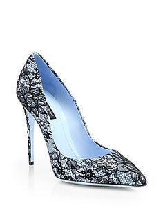"Dolce & Gabbana Kate Bright Blue Patent Leather with Black Lace Pumps   Details Bright-hued patent leather is overlaid with exquisite floral lace for an undeniably romantic yet modern effect.  Self-covered heel, 4.13"" (105mm) Patent leather upper with floral lace overlay Point toe Leather lining and sole Padded insole Made in Italy"