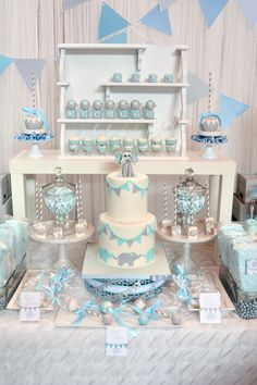 Baby Nicolas is coming to play!     This nursery inspired, baby blue and gray, elephant baby shower, dessert table was designed for our m...