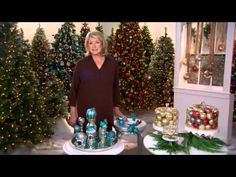 Ways to Decorate with Ornaments : Clear domed cake plate filled with ornaments; cedar around base. Ornaments on silver candlesticks on a mirror tray w/glitter trim at base. Ornaments hung on ribbons at window with snowflake attached at the top.