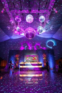 Wow!!! Gorgeous dance floor setup at this purple and blue uplighting wedding reception! Love the starry night on the ceiling!