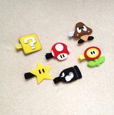 6 Nintendo Hair Clips Alligator Barrettes - Mushroom, Goomba, Flower Power, Bullet, Coin Box and Star. $18.50, via Etsy.