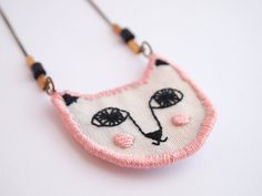 Pink pale cat embroidered necklace by LanaPelana on Etsy