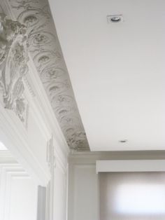 Close up, classic moldings and modern ceiling, NP apartment in Paris _