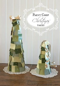 A fancy table ornament for the holidays — paint chip Christmas trees.  Source: Making Home Base