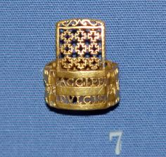 """Roman, 2nd-3rd century AD. Gold finger-ring with open-work decoration, inscribed: """"Take it, sweet one, for many years.""""."""