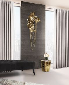 Made of brass with gold plated and handmade butterflies and majestic flowers ending with the touch of beautiful Swarovski crystals. The wall version of McQueen Chandelier, this master piece causes a dramatic and eccentric sensation of beauty.