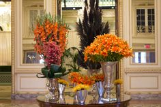 This week at The Plaza Hotel you'll find Gladiolus, Cymbidium Orchids, Pincushion Protea, Lilies and Black Feather Cattails in hues of bright, beautiful orange that to help start the week of right! #flowers #luxury