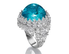 Harry Winston one-of-a-kind cabochon Paraiba tourmaline and diamond ring. Discover the many blue and green hues of the gemstone that is taking the jewellery and fashion designers by storm: the Paraiba tourmaline. http://www.thejewelleryeditor.com/jewellery/the-story-of-the-paraiba-tourmaline-is-as-fascinating-as-its-incomparable-colour/ #jewelry