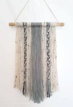 """Hello, Lovelies! This handmade yarn wall hanging is for the simple bohemian! With soft contrasting colors, it is sure to add that modern neutrality into your home. ~Product comes in 2 sizes: -12"""" by 17"""" -24"""" by 24"""" ~Colors: You can choose the desired color through customization, just"""