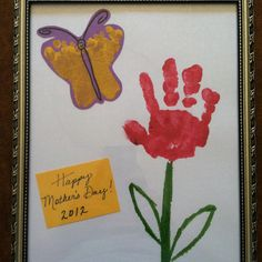 Baby footprint butterfly and toddler handprint flower. Made by Olivia and Claire for our moms for mother's day.