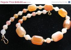 From my teammate www.BelladonnasJoy.etsy.com - A lovely gemstone chocker necklace with carnelian, aventurine, jade and freshwater pearls. Discounted during the SPS Team sale - plus free shipping.  Orange Carnelian Choker Necklace Multi Gemstone by BelladonnasJoy