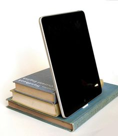 This book pile iPad stand would work well in a kitchen, for bookish cooks who love to read recipes off of their device.