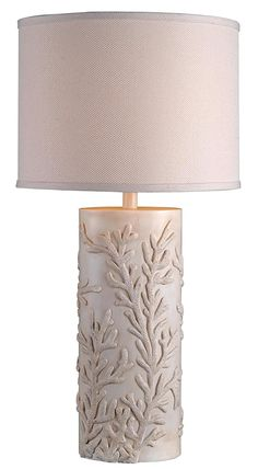 Get the Kenroy Coral Reef Coastal Table Lamp, which is a cylinder shaped table lamp that features a subtle coral reef design. It's neutral in color overall.