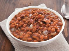 Bacon and baked beans come together in this slow cooked side dish that's sweet and sour.