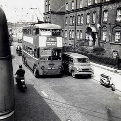 Hammersmith trolley bus 1960 outside Guinness Trust Fulham Palace Rd