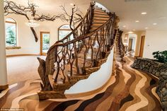 Two of the property's highlights are the staircases, one pictured, which feature wooden sculptures of an eagle and a fish at their bases