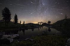The Perseid Meteor Shower shoots across the sky in the early hours of August 13 2015 appearing to cascade from Mount Shasta in California USA. The composite image features roughly 65 meteors captured by the photographer between and Photo by Brad Goldpain Mount Shasta, Photos Du, Cool Photos, Foto Flash, Astronomy Photography, Ciel Nocturne, Perseid Meteor Shower, Night Sky Photos, Astronomy Pictures