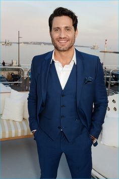 May 2016: Donning a three-piece blue suit from BOSS Hugo Boss, Édgar Ramírez is all smiles as he attends The Weinstein Company's Hands of Stone cocktail party during the 2016 Cannes Film Festival.