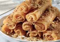 Diples Greek sweets with honey and walnuts Greek Sweets, Greek Desserts, Köstliche Desserts, Greek Recipes, Delicious Desserts, Winter Desserts, Beignets, Greek Fries, Cyprus Food