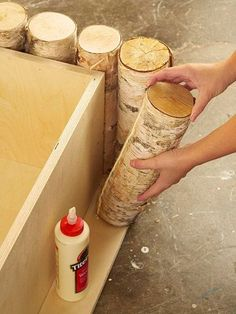 Step 4: Cut logs to 18' using a miter saw. Bead wood glue along one side and on bottom of each log. Secure logs to the wood base and box. For extra strength, screw through the wood box into each leg.