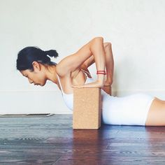 Place two blocks at the lowest height next to the mid-upper ribcage below the armpits. Place the hands on the blocks with the fingers flat on the block rather than curled over the edge. (This will help stretch the underside of the forearms)