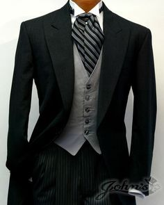 """Dark Grey Cutaway Tuxedo The cutaway tailcoat is the centerpiece for the dress code known as """"Morning Dress"""", intended for daytime formal occasions. The Cutaway features a single breasted, one-but… Tuxedo Wedding, Wedding Men, Wedding Suits, Wedding Attire, Gothic Wedding, Wedding Ideas, Groom Tuxedo, Groom And Groomsmen, Sharp Dressed Man"""