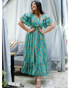 Shop online Turquoise and peach floral printed flutter dress Turquoise and peach hand block printed dress crafted in muslin silk fabric. It comes with layered flutter sleeves, v-neck and side zipper. Stylish Dresses For Girls, Frocks For Girls, Stylish Dress Designs, Dresses For Women, Girls Frock Design, Long Dress Design, Indian Gowns Dresses, Indian Fashion Dresses, Casual Frocks