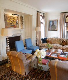 overstuffed linen chair with stripe detail . Katie Ridder . New York Social Diary
