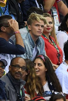 Hair-raising: Cody's blonde mop went a little wild while watching the  swimming semifinals...