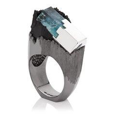 "Ornella Iannuzzi - Ring ""A l'Ère Glacière"" Aquamarine on Schorl (black tourmaline) set in black rhodium silver, and silver crystal set with a cut aquamarine, 2012."