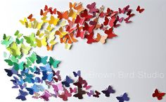 Find out how to make an easy, do-it-yourself art project from free paint samples, paper punches and a large piece of foam core. This colorful butterfly swarm is a kid-friendly activity. We made it in a couple of hours, including time to get the paint samples at Home Depot.