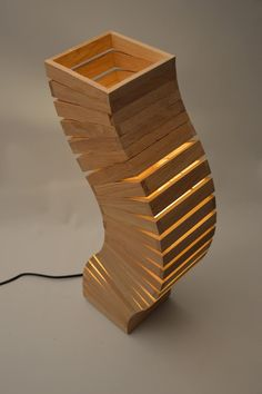 Backbone is a design lamp in recycled oak wood.Its unique design recalls the line of a spine.            Lamp type: GU10 230V spot, energy-saving lamp included. Dimensions: 54cm x 30cm x 13cm  More information here: Backbone #Bedroomdecor #Bedside #Handmadelighting #Lamp #Lightfixture #Lighting #Lightingdesign #Modernlighting #Oak #Recycle #Woodlamp #Woodworking