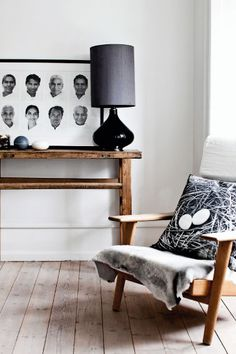 """The chair is an heirloom from the 1970s. The pillow is from City North. The lamp is from Rue Verte Plus and the image are photos made by photographer Soren Solkær """"Starbird"""", depicting Indian yogis. The table is from Green Square"""