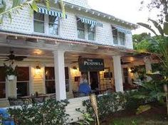 The Peninsula Inn Boutique Hotel in Gulfport, FL. Elegant Indoor & Outdoor Dining.