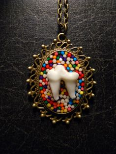 Sweet Tooth Real Fox Tooth Candy Cameo Necklace by TheCuriositeer