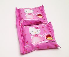 MARSHMALLOW SANDWICH Hello Kitty Marshmallow Lotte Pie: This cute snack consists of two soft, delightfully spongy cookies filled with fluffy marshmallow cream and covered in a smooth chocolate flavored coating.